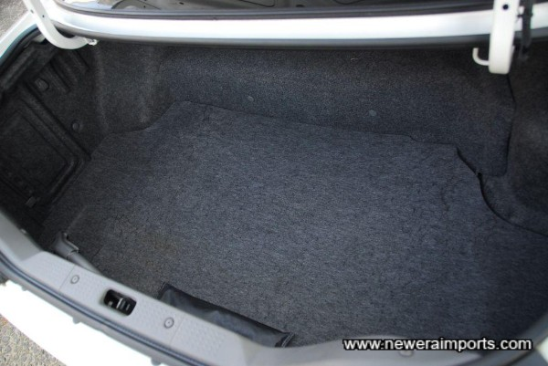 Trunk carpet has some wear, but is in presentable condition.