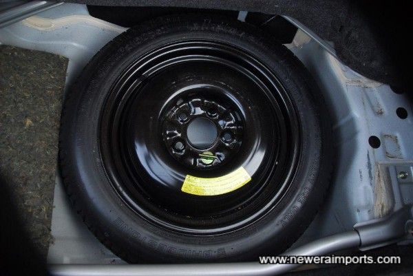 Spare wheel is unused. Note the sealant is all original.