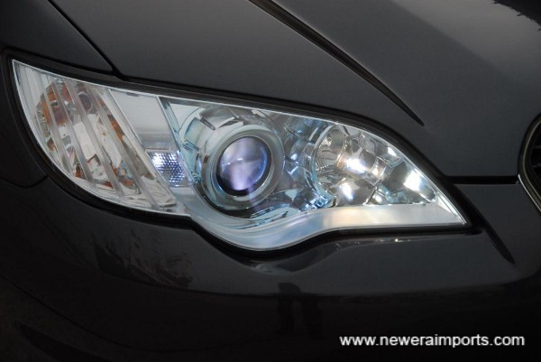 Facelift model has updated (HID) headlights.