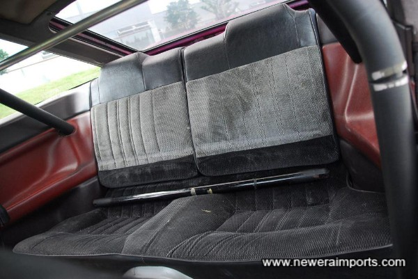 Back seat. Diagonal bar for half roll cage is included.