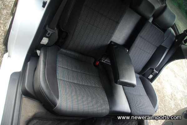 Rear seats are reclinable and have 3 x 3 point seatbelts (Centre is anchored to the ceiling).