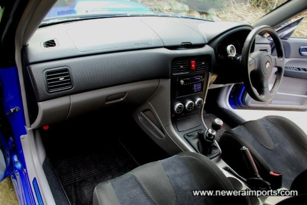 Interior's in excellent condition. This has been a meticulous non smoker's car since new.