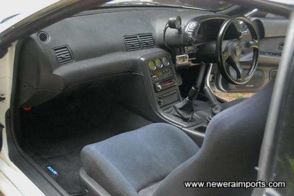 Interior is in good condition in keeping with low original mileage.