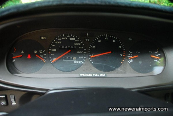 Odometer shows mileage in km since new (Documented).