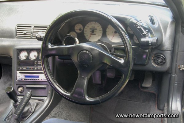 Steering wheel is in good condition with only minor wear at the top.