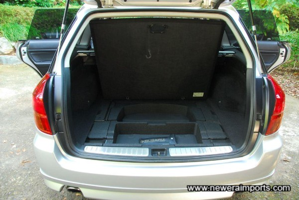 Storage under the trunk compartment.
