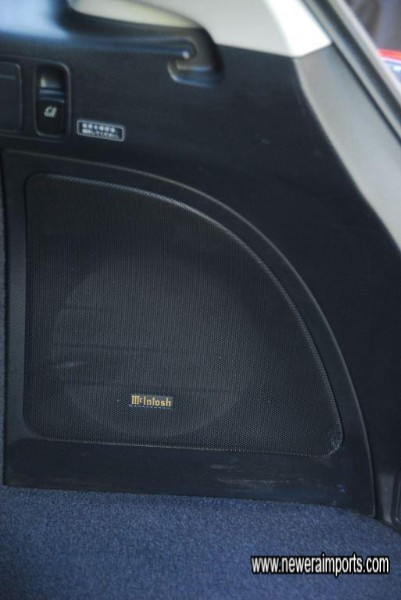 Integrated high quality woofer is part of the McIntosh 6 CD changer in dash high power sound system.