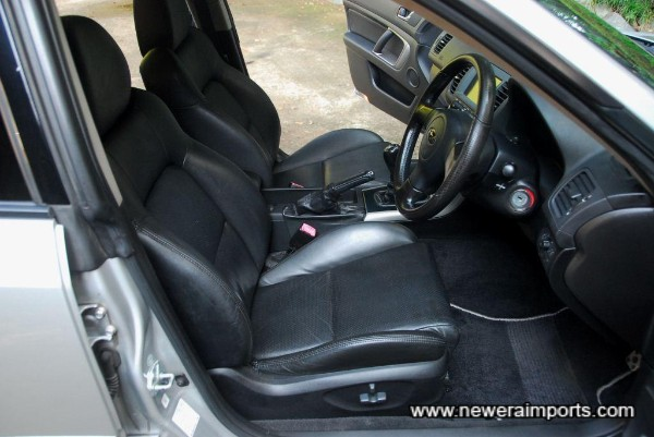 Driver's seat is electrically adjustable and heated.