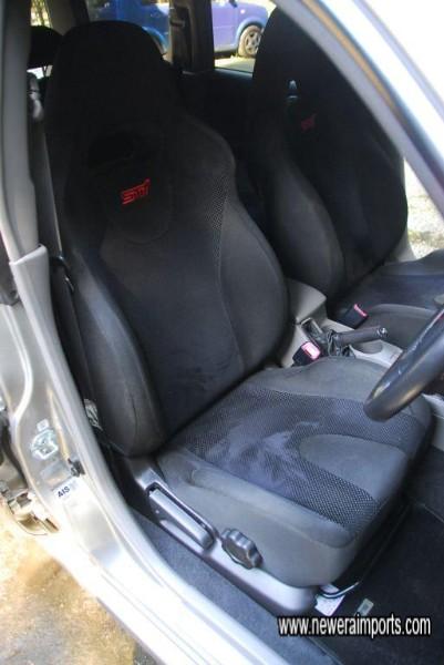 Driver's seat is unworn.