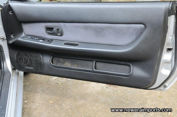 Driver's door card was replaced by ourselves, since the original's alcantara had come off & been poorly repaired.