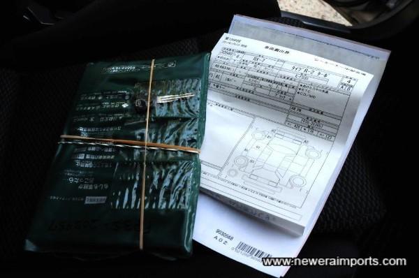 Original auction sheet & service book in folder.