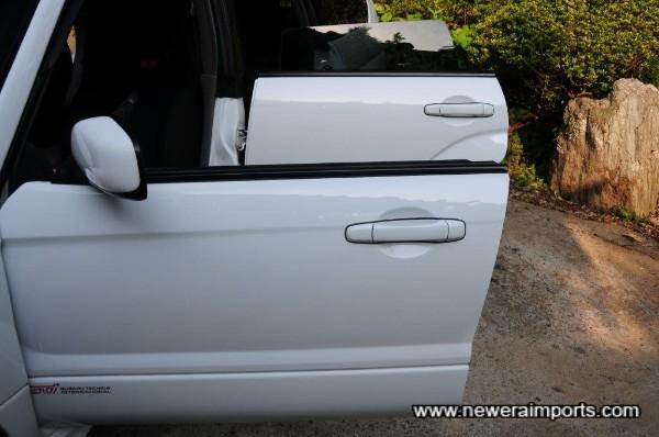 Pillarless windows - a Subaru trademark.
