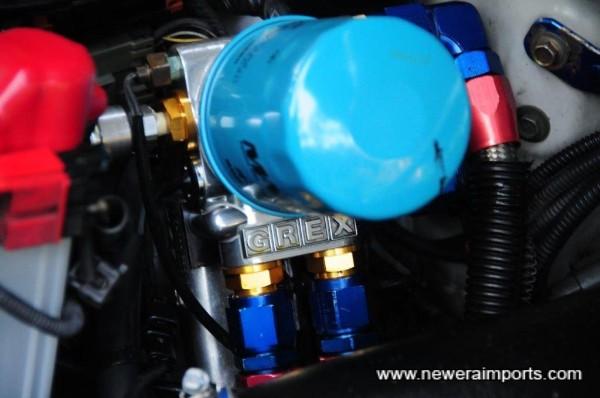 Greddy remote oil filter mount (& also gauge sensor mount).