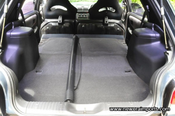 Rear seats fold to allow ample carrying capacity.