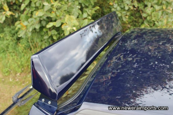 Rear spoiler mounts raised using special adaptors for rally style.