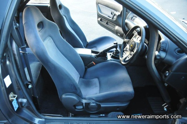 Driver's seat is unworn in keeping with low mileage.