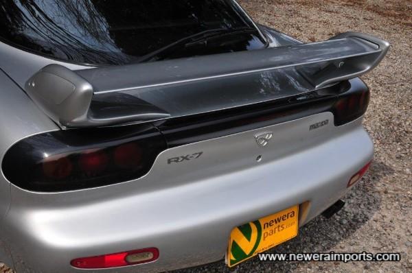 Original 1999 + adjustable rear spoiler.