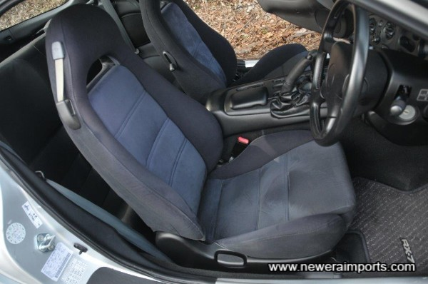 Driver's seat is unworn in keepign with low genuine mileage.