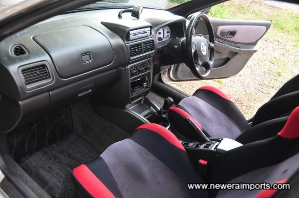 Interior is unworn in keeping with original low mileage.