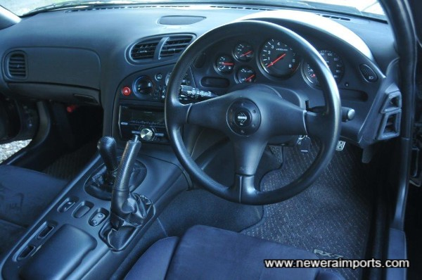 Momo genuine leather steering wheel is an OEM feature on this RX-7.