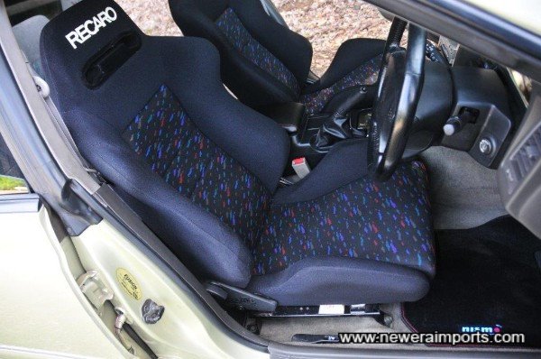 Recaro SR-III is supportive & comfortable. Also reclinable.