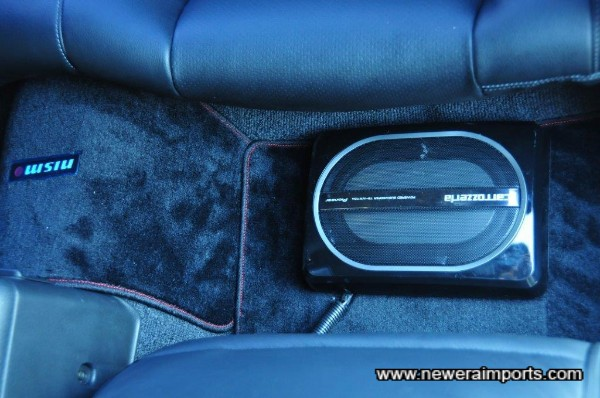 Powered Sub Woofer is located behind the passenger seat.