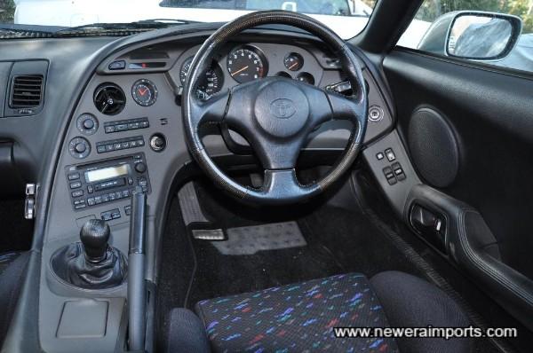 Original option carbon fibre trimmed SRS steering wheel.