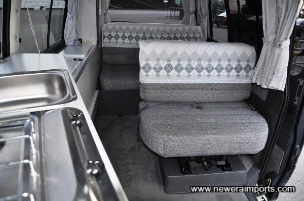 This seat swivels and also folds down to make the bed.