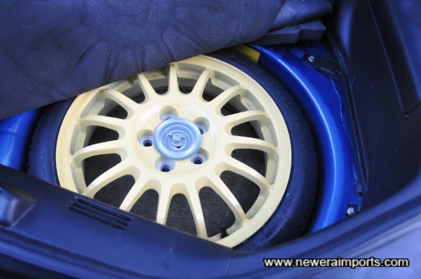 RS models have a lightweight alloy spare with spacesaver.