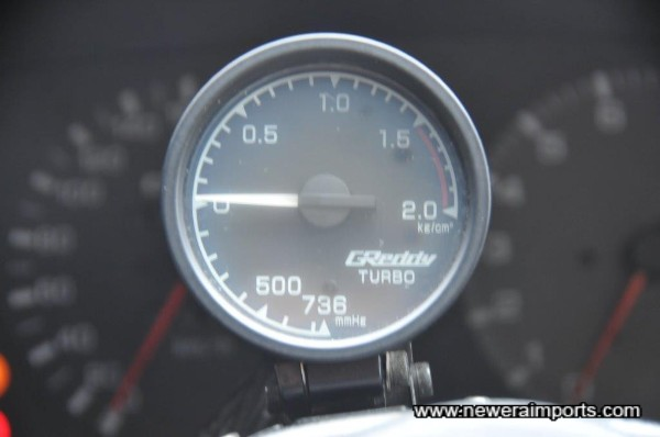 Boost gauge (60mm) is mounted neatly on the steering column.