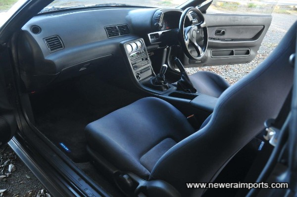 Interior is unworn in keeping with low mileage.