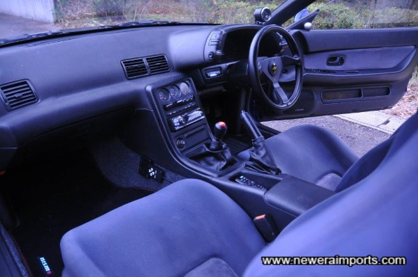 Interior is unworn in keeping with low original mileage.