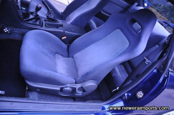 Seats are unworn in keeping with low original mileage.