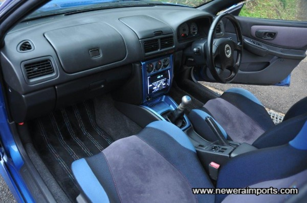 Interior is unworn, in keeping with low mileage.