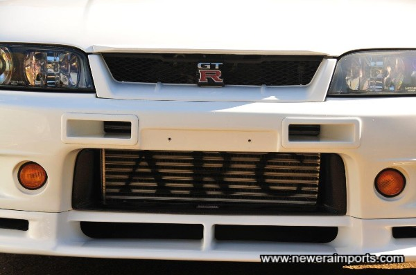 ARC Twin pipe intercooler enclosed by rare original Nismo intercooler shroud.