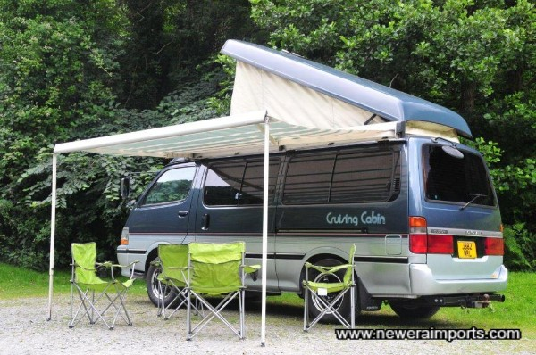 With canopy opened and 4 foldable chairs (included with this vehicle)